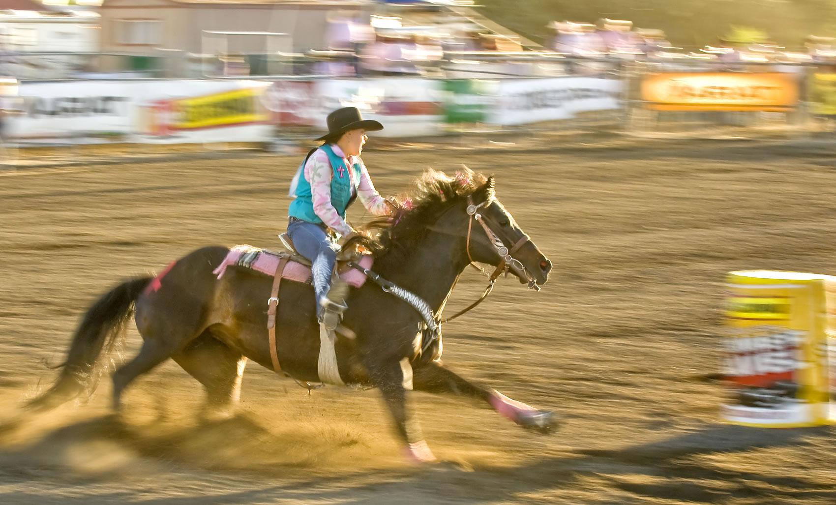 Woman barrel racing